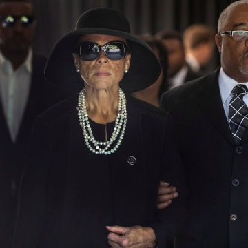 Image: Lonnie Ali, widow of Muhammad Ali, leaves the funeral home to begin a procession through his hometown of Louisville