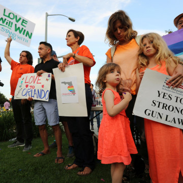 Image: People attend a vigil in West Hollywood
