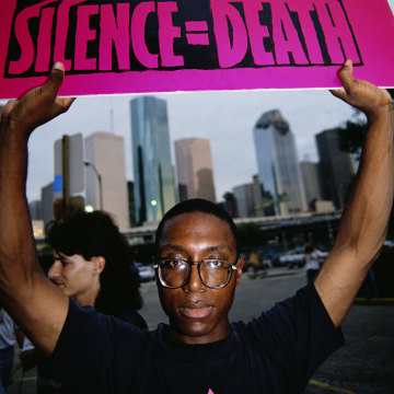 Gay Rights Protester Holding Sign Above His Head