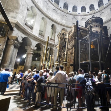 Image: Christian pilgrims wait in line to visit the tomb of Jesus Christ in the Church of Holy Sepulcher