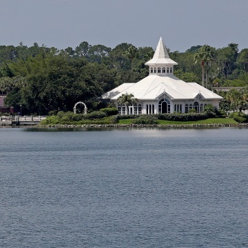 Image: A search boat is seen in the Seven Seas Lagoon, in front of a beach at the Grand Floridian, at the Walt Disney World resort in Orlando, Florida