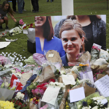 Image: Tributes in memory of murdered Labour Party MP Jo Cox, are left at Parliament Square in London