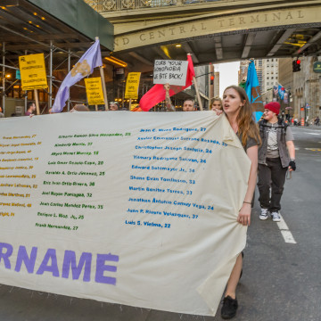 A group of about 200 people held a rally at Grand Central