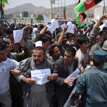 Image: Afghan protesters shout slogans during a demonstration against Taliban militants and the kidnapping of civilians