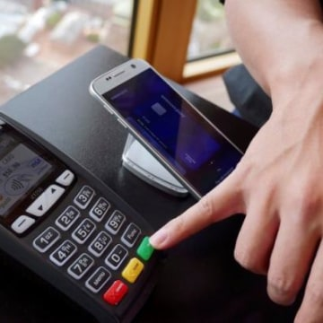 Samsung's new Samsung Pay mobile wallet system is demonstrated at its Australian launch in Sydney