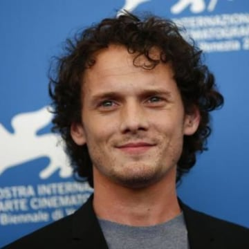 """Cast member Yelchin poses during the photo call for the movie """"Burying the ex"""" at the 71st Venice Film Festival"""