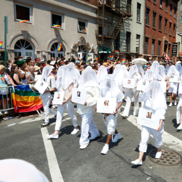 Ghosts representing the Orlando Massacre victims march in the 2016 New York City Pride March