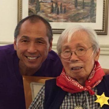 The author, left, with his father, Benny Kwong.