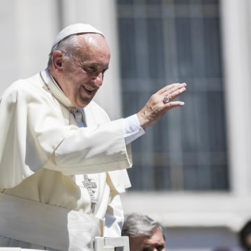 Pope Francis greets the faithful as he leaves at the end of