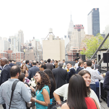Members of The Alumni Society who attended the annual leadership summit gather on the rooftop of Hudson Mercantile for a cocktail hour.