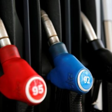 Petrol pump nozzles are pictured at fuel station of M10-Oil company in Tver