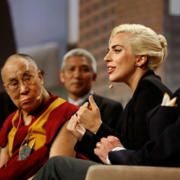 "Image: The Dalai Lama and singer Lady Gaga appear together for a question and answer session on ""the global significance of building compassionate cities"" at the U.S. Conference of Mayors 84th Annual Meeting in Indianapolis"