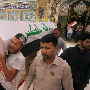 Image: Mourners carry coffins of Baghdad bombing victims