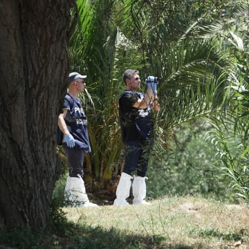 Image: Forensic police scan the banks of the Tiber river in Rome