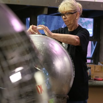 Image: Yolanda Baker assembles a disco ball