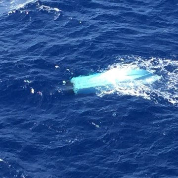 Image: The Coast Guard and the Navy are searching for three missing fishermen reported overdue north northwest of Oahu