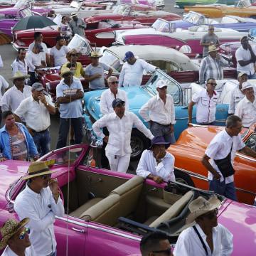 Drivers of vintage American cars in Havana, Cuba.