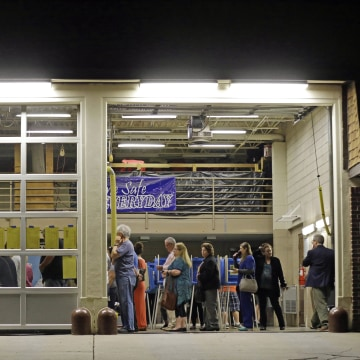 Image: Voters line up before daylight to cast their ballots in Cary, N.C