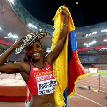 Caterine Ibarguen of Colombia celebrates after winning gold