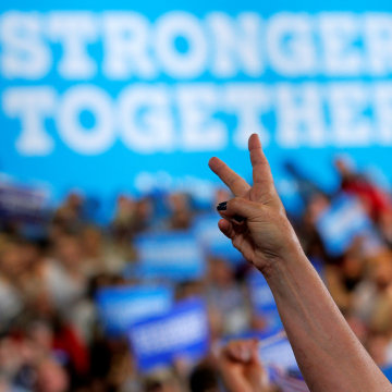 Image: Audience members cheer during a campaign rally with U.S. Democratic presidential candidates Hillary Clinton and Senator Bernie Sanders in Portsmouth