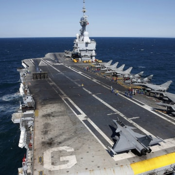 Image: File photo of Rafale and Super Etendards fighter jets are parked prior to a mission aboard France's Charles de Gaulle aircraft carrier sailing in the Gulf