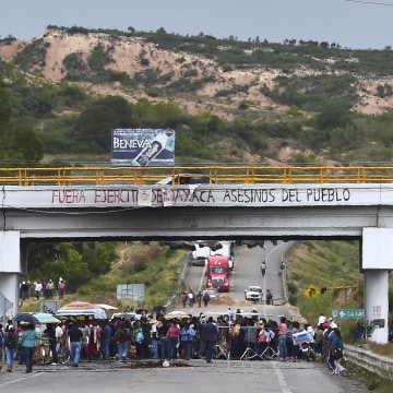 Teachers block a road at the entrance of the village of Nochixtlan, Oaxaca State, Mexico on July 4, 2016.