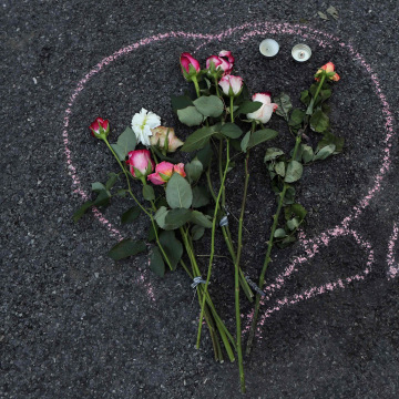 Image: Flowers left on a road in Nice, France, for victims of Bastille Day truck attack
