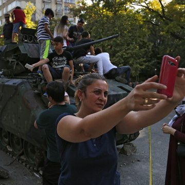 Image: Woman takes a self near Turkish military vehicle on July 16, 2016