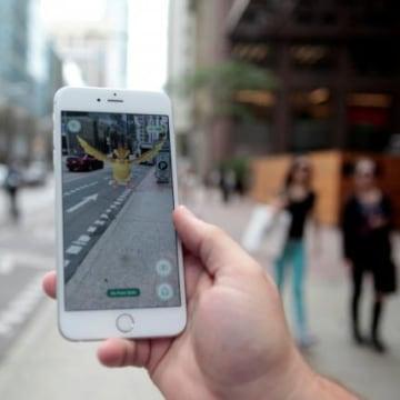 "Photo illustration of a ""Pidgey"" Pokemon seen on the screen of the Pokemon Go mobile app"
