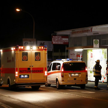 Image: German emergency services workers work in the area where a man with an axe attacked passengers on a train