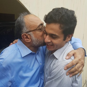 Image: Chief Justice Sajjad Ali Shah of the Sindh High Court in Karachi embraces his son after he was rescued