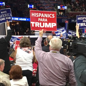 "Man holds ""Hispanics Para Trump"" sign at the 2016 Republican Convention."