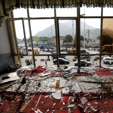 Image: Broken glass and debris are seen inside a resturant a day after a suicide attack in Kabul
