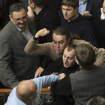 Image: Ukrainian deputies fight during a session of parliament in Kiev