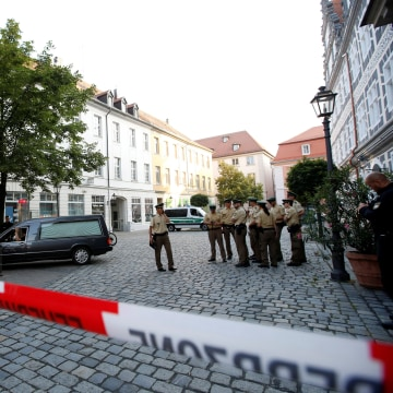 Image: A hearse leaves the area after an explosion in Ansbach