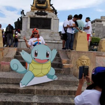 "Fans of the augmented reality mobile game ""Pokemon Go"" by Nintendo participate in a ""poketour"" organized by the municipality in San Salvador"