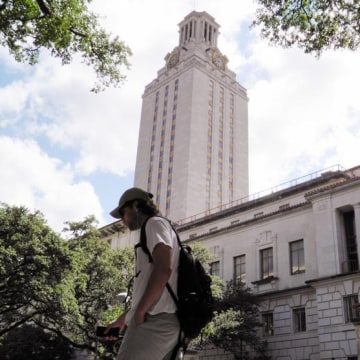 A student walks at the University of Texas campus in Austin