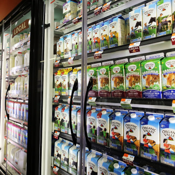 Image: Milk is displayed on shelves in a Brooklyn supermarket on June 9 in New York City. Milk prices for Americans have been on the rise recently with a 7.5% price increase for a gallon of fortified whole milk from last year.
