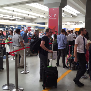 Image: U.S.-bound Delta passengers at Rome's Fiumicino Airport waited more than an hour in line to check-in early Monday.