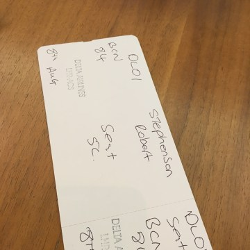 Image: A handwritten Delta boarding pass, issued because the airline's computer system is down, given to passenger Rob Stephenson, 42, of Ann Arbor, Michigan at London's Heathrow Airport.