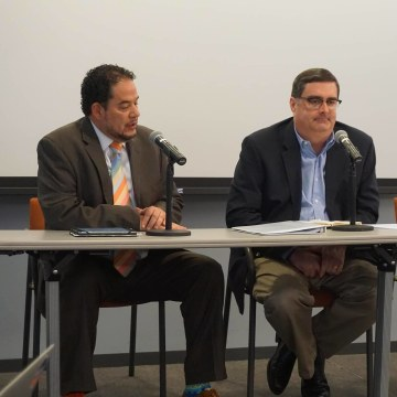 Hector Cordero-Guzman (left) and Sergio Marxuach (right) discuss the PROMESA Act and the Puerto Rican debt crisis.