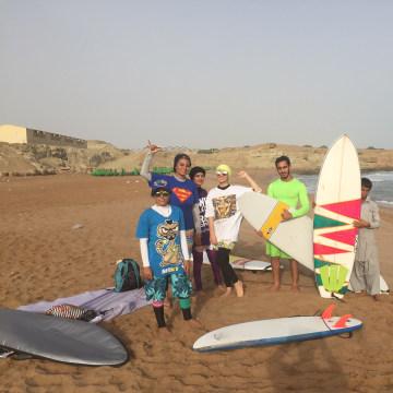 Image: Mona Seraji, left, stands alongside other surfers