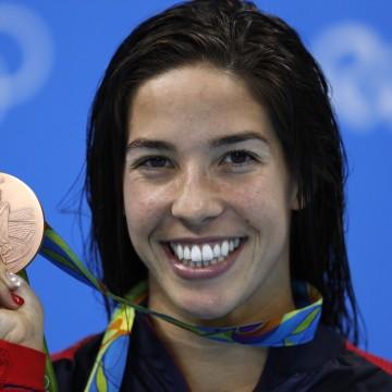 "USA's Madeline ""Maya"" Dirado poses with her bronze medal"