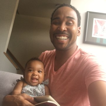 David Johns reads to niece