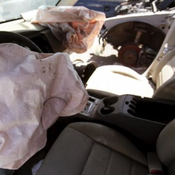 Deployed Takata manufactured airbags are seen on the driver and passenger side of a 2007 Dodge Charger at a recycled auto parts lot in Detroit, Michigan
