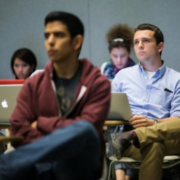 Students listen while classmates make presentation to group of visiting venture capitalists during Technology Entrepreneurship class in Stanford