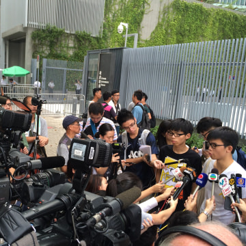 Image: Joshua Wong (second right, wearing black) in Sept. 2014
