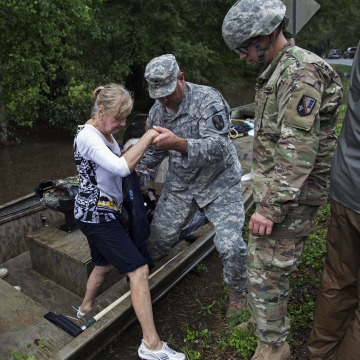 Image: Members of the Louisiana Army National Guard rescue people