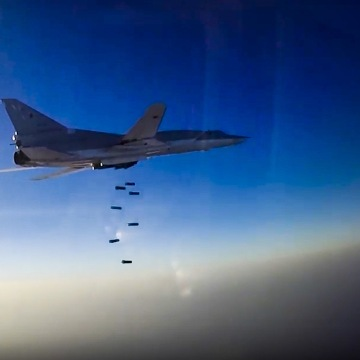 Image: An image provided by Russia's defense ministry shows a Russian Tu-22M3 bomber during an air strike over Aleppo, Syria on Tuesday.