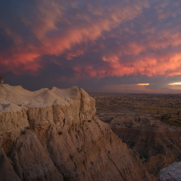 Image: Clouds are transformed by a sunset at Badlands National Park